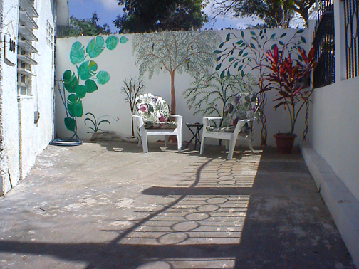 wall painting on outer wall in front of house on patio